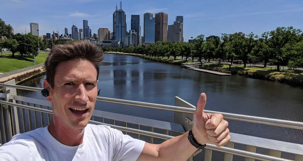 Andy on his run with Melbourne CBD in background