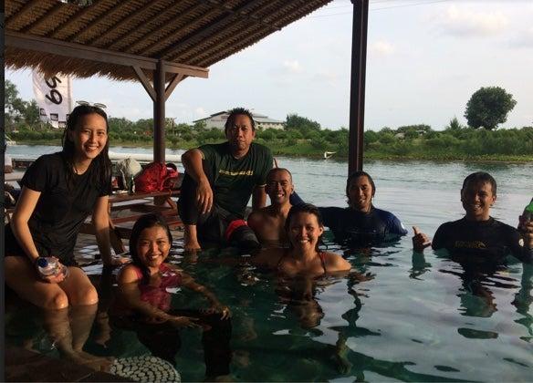 Team members in the water