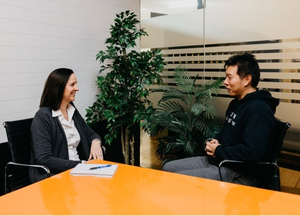 Team member meeting with senior HR consultant