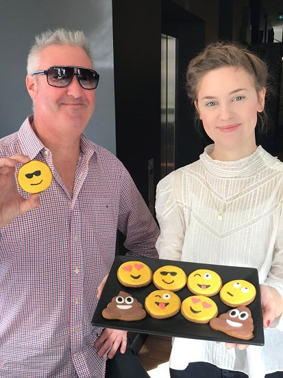 Kate and Jase with Emoji Cookies for World Emoji Day