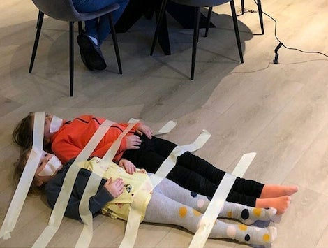 Kids masking taped to the floor