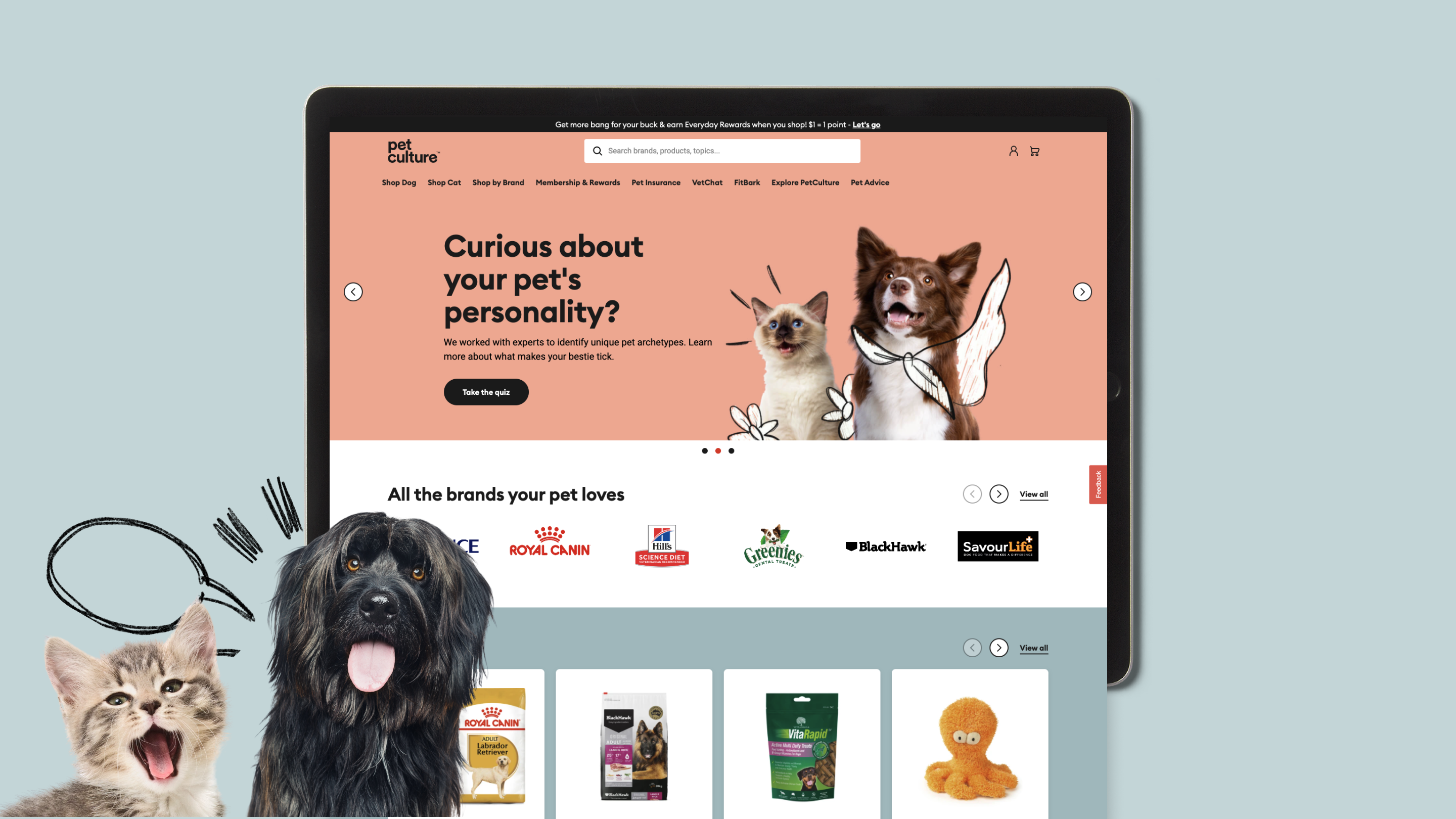 Pet Culture website on tablet with cat and dog in foreground